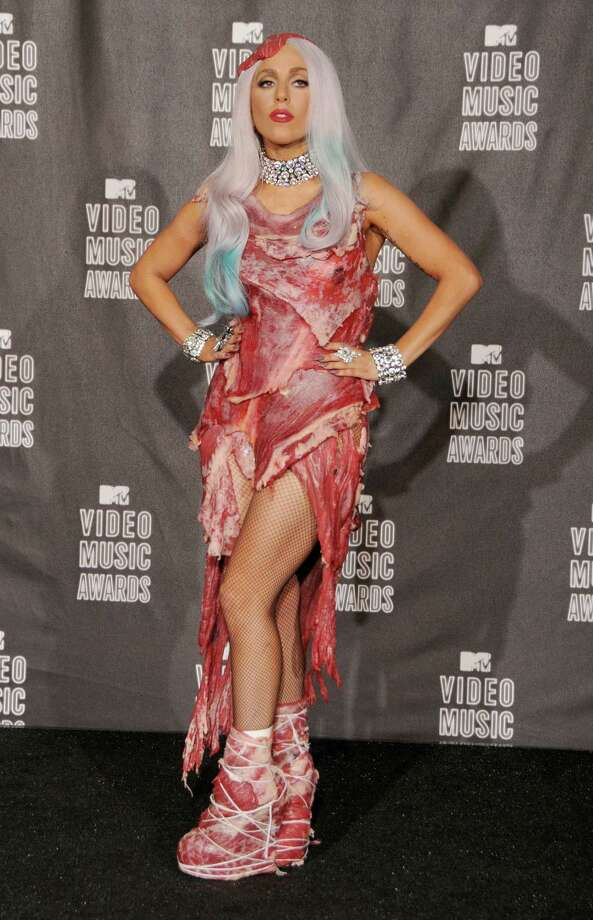 "2010: Lady Gaga poses in the press room in the famous ""meat dress."" Photo: Gregg DeGuire, Gregg DeGuire/PictureGroup / 2010 Gregg DeGuire"