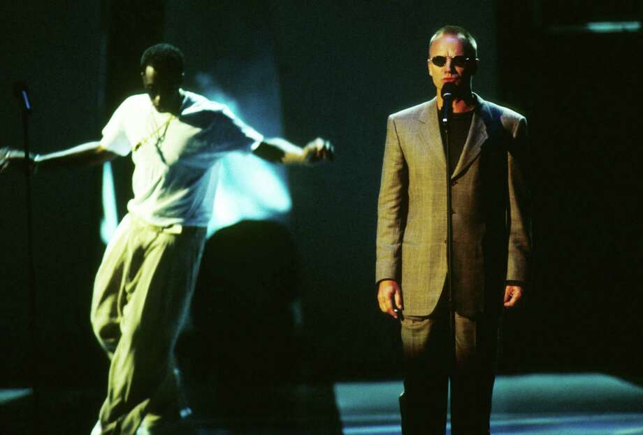 1997: Sting (right) and Puff Daddy perform. Photo: Frank Micelotta, Getty Images / Hulton Archive