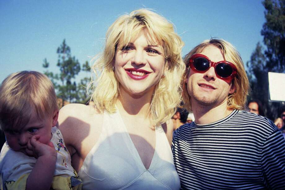 1993: Kurt Cobain of Nirvana (right) with wife Courtney Love and daughter Frances Bean Cobain. Photo: Terry McGinnis, WireImage / WireImage