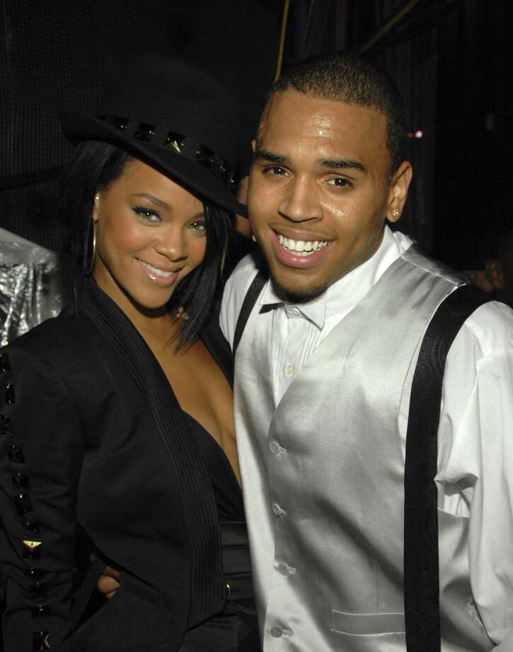 2007: Rihanna and Chris Brown backstage. About 15 months later, Brown would beat Rihanna in a much-publicized incident of domestic violence. Photo: Kevin Mazur, WireImage / WireImage