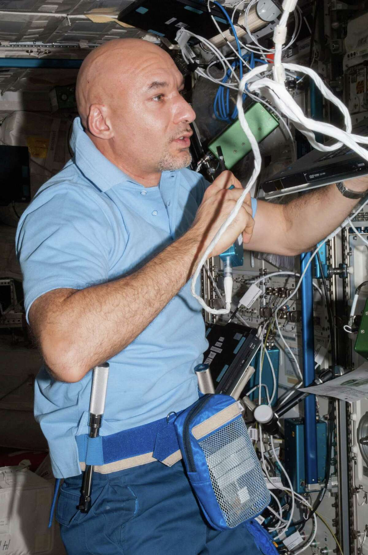 European Space Agency astronaut Luca Parmitano is shown at work in the International Space Station a week after he nearly drowned during a spacewalk on July 16.