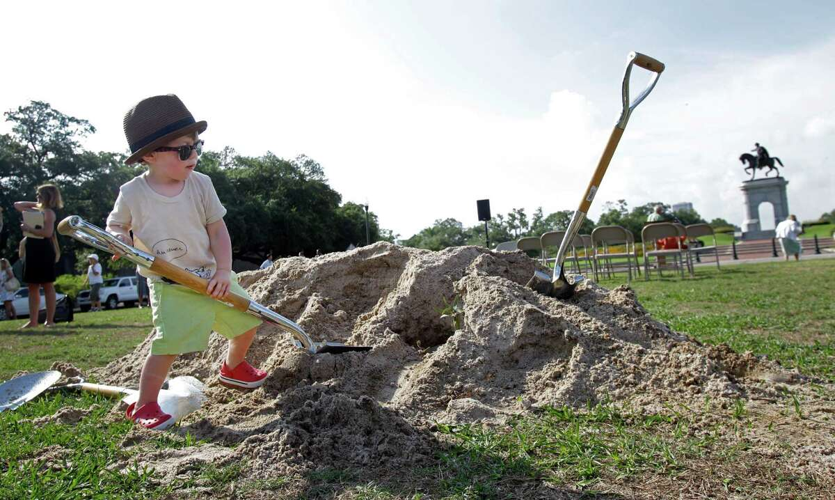 Elliott David, 3, plays in dirt after the Hermann Park Conservancy ground breaking ceremony for the Grand Gateway renovation project at Hermann Park Tuesday, Aug. 20, 2013, in Houston. He is the son of Danny David, vice president of Hermann Park Conservancy. The Grand Gateway, the historic main entrance to Hermann Park, will undergo a $5 million renovation and is set to be completed in March 2014. The Grand Gateway includes the area from the Mecom Fountain to the Sam Houston Monument and the area of parkland on the esplanade between Fannin and Main known as Cravens Parkway.