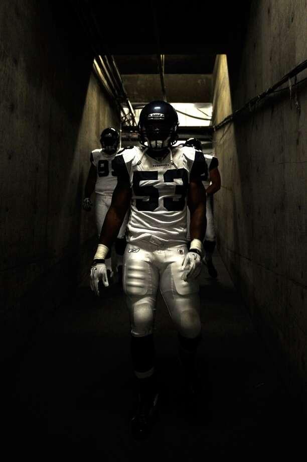Linebacker Malcolm Smith of the Seattle Seahawks stands in the tunnel before taking on the San Diego Chargers during the NFL preseason game at Qualcomm Stadium on August 11, 2011 in San Diego, Calif. Photo: Kevork Djansezian, Getty Images