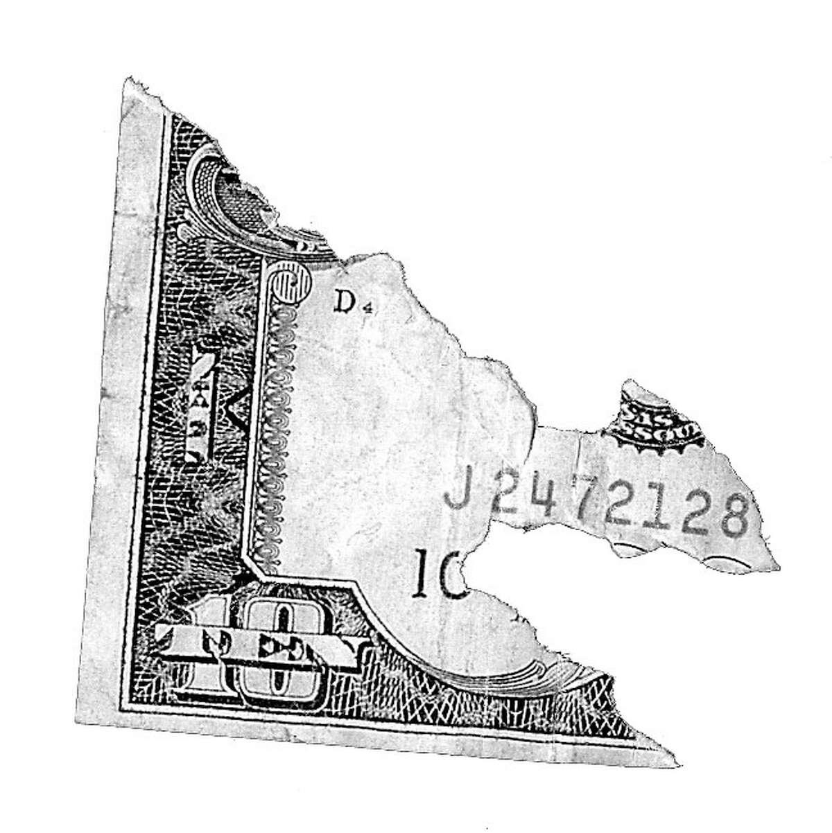 illustration for business EATEN DOLLAR BILL HOUCHRON CAPTION (12/27/1999): None.