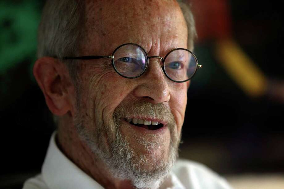 FILE - In this Monday, Sept. 17, 2012 file photo, Author Elmore Leonard, 86, smiles during an interview at his home in Bloomfield Township, Mich. Leonard, a former adman who later in life became one of America's foremost crime writers, has died. He was 87. His researcher says he passed away Tuesday morning, Aug. 20, 2013 from complications from a stroke. (AP Photo/Paul Sancya) ORG XMIT: NYEL102 Photo: Paul Sancya / AP