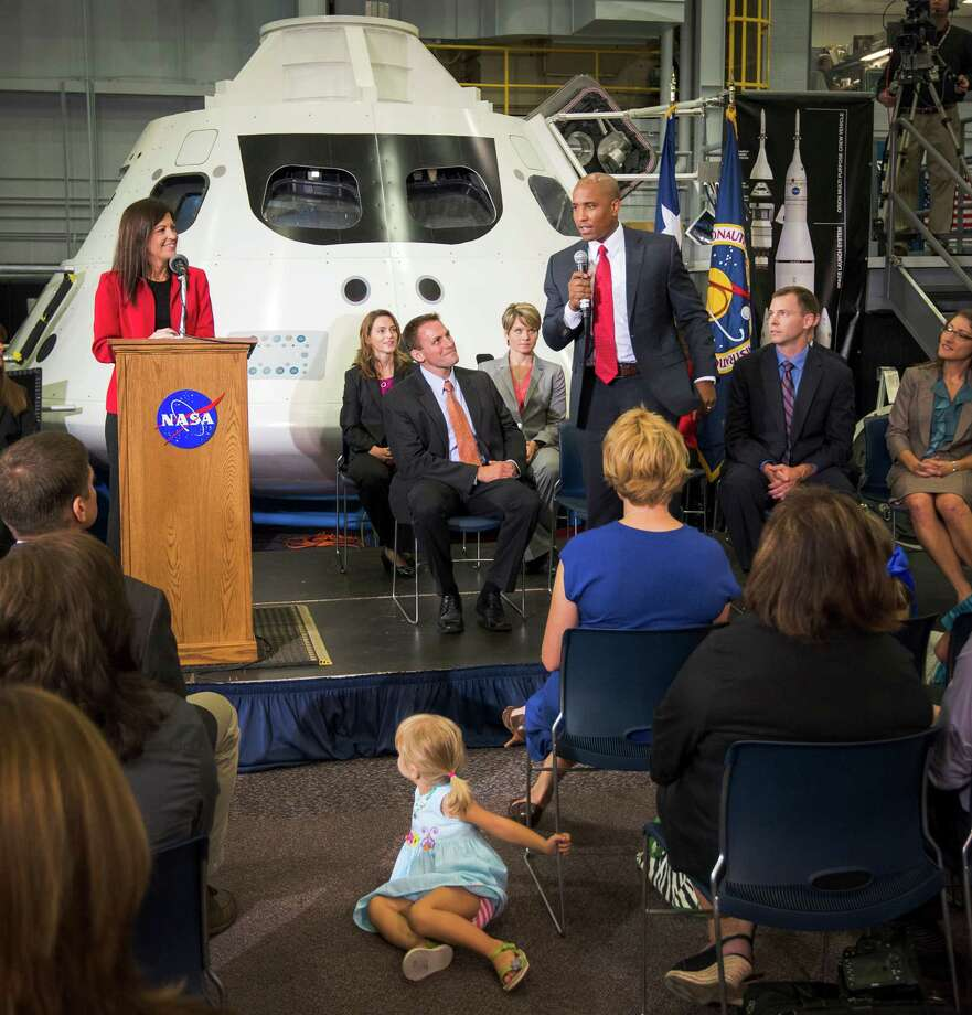With their families in attendance, the newest class of astronaut candidates are seated in front of a mockup of the Orion crew vehicle as candidate Victor J. Glover answers a question during a press conference at the Johnson Space Center on Tuesday, Aug. 20, 2013, in Houston. Photo: Smiley N. Pool, Houston Chronicle / © 2013  Houston Chronicle