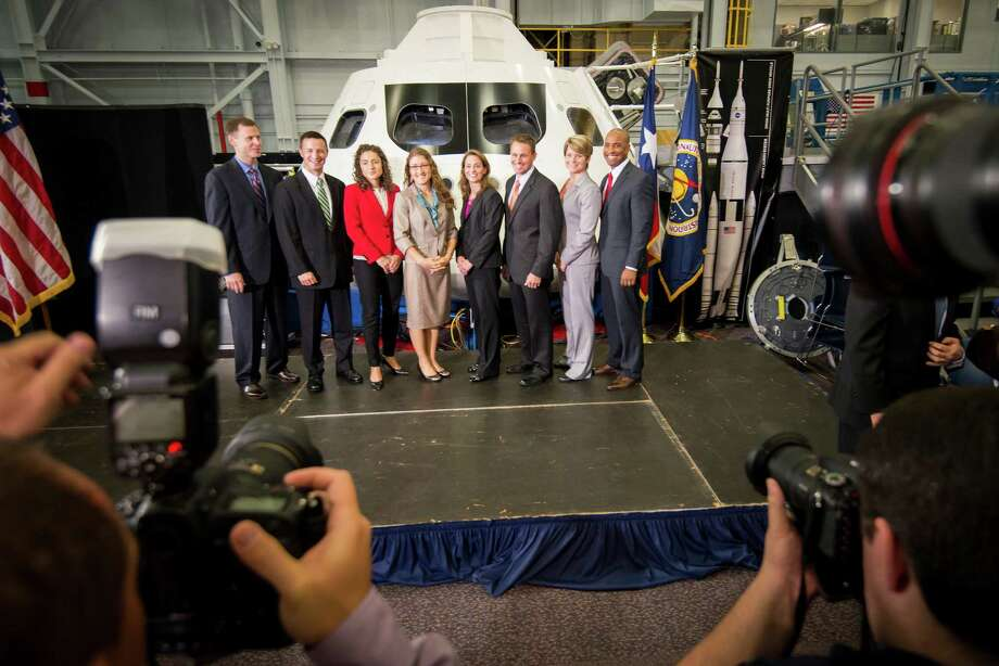 The newest class of astronaut candidates, from left, Tyler N. Hague, Andrew R. Morgan, Jessica U. Meir, Christina M. Hammock, Nicole Aunapu Mann, Josh A. Cassada, Anne C. McClain and Victor J. Glover pose for a group photo following a press conference at the Johnson Space Center on Tuesday, Aug. 20, 2013, in Houston. Photo: Smiley N. Pool, Houston Chronicle / © 2013  Houston Chronicle