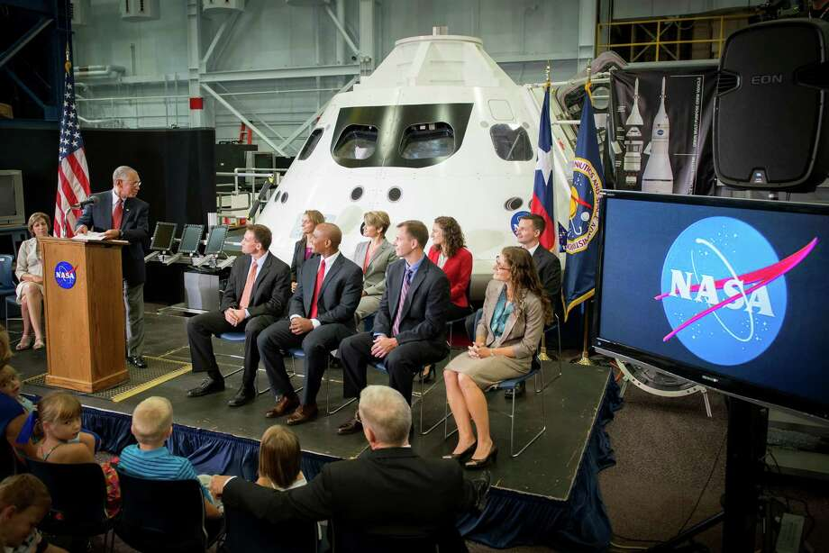 The newest class of astronaut candidates are seated in front of a mockup of the Orion crew vehicle as they listen to NASA Administrator Charles Bolden during a press conference at the Johnson Space Center on Tuesday, Aug. 20, 2013, in Houston. Photo: Smiley N. Pool, Houston Chronicle / © 2013  Houston Chronicle