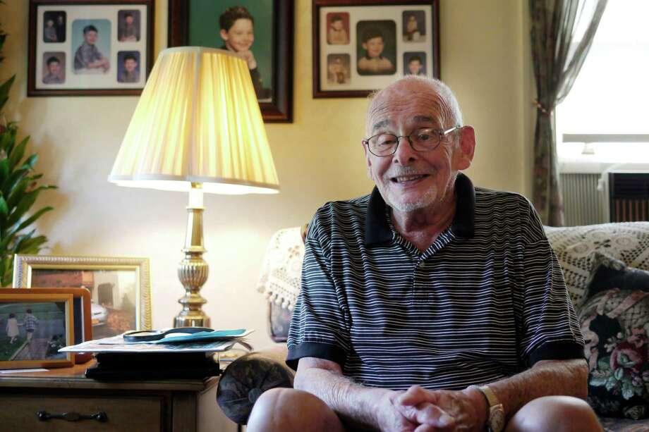 Holocaust survivor Martin Becker sits in the living room at his home Tuesday, Aug. 20, 2013, in Albany, N.Y.  (Paul Buckowski / Times Union) Photo: Paul Buckowski / 00023575A