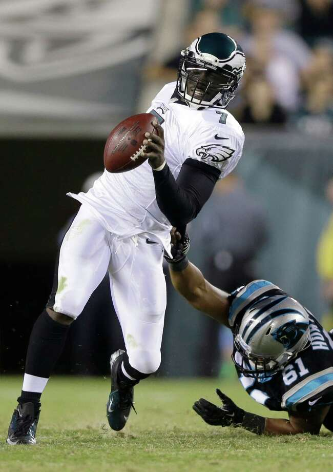 Philadelphia Eagles' Michael Vick, left, is tackled by Carolina Panthers defensive end Wes Horton during the first half of a preseason NFL football game, Thursday, Aug. 15, 2013, in Philadelphia. (AP Photo/Matt Rourke) ORG XMIT: PXE111 Photo: Matt Rourke / AP