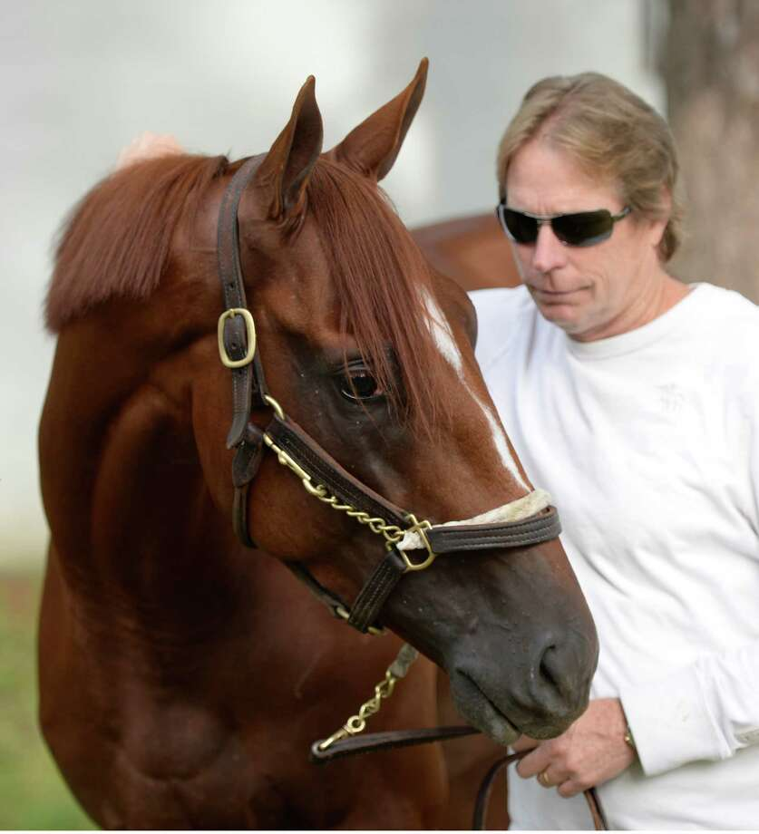 Trainer Dallas Stuart with his Travers Stakes entrant Golden Soul Monday morning, Aug 19, 2013, at the Oklahoma Training Center in Saratoga Springs, N.Y.   (Skip Dickstein/Times Union) Photo: SKIP DICKSTEIN