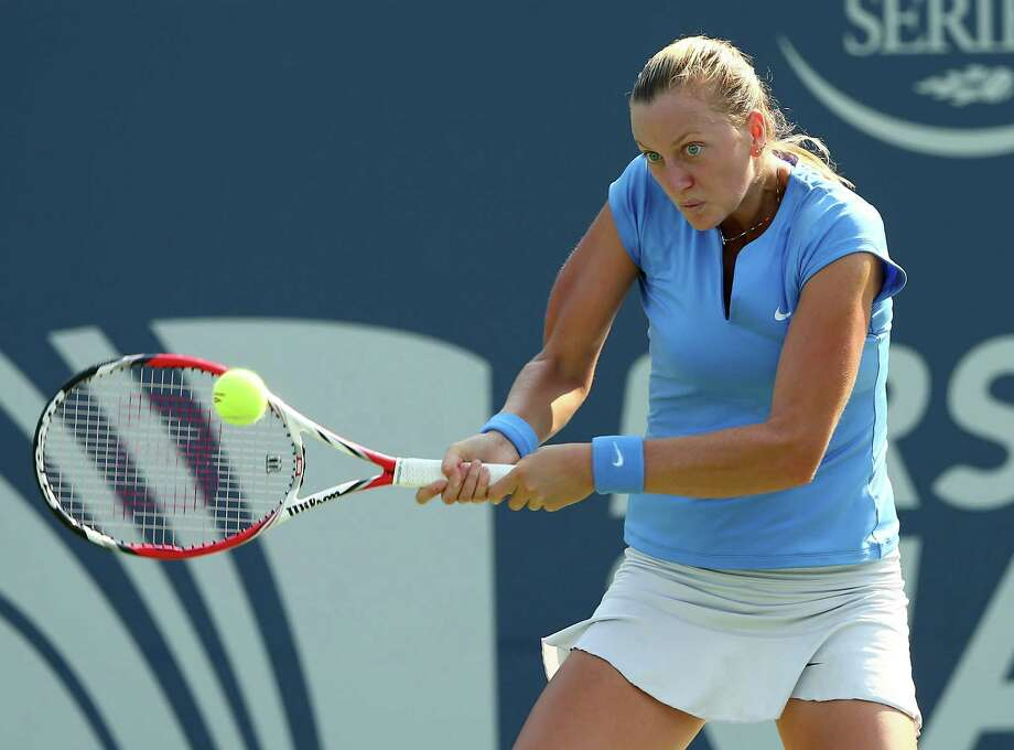 NEW HAVEN, CT - AUGUST 20:  Petra Kvitova of the Czech Republic returns a shot to Annika Beck of Germany during Day Three of the New Have Open at Connecticut Tennis Center at Yale on August 20, 2013 in New Haven, Connecticut. Photo: Elsa, Getty Images / 2013 Getty Images