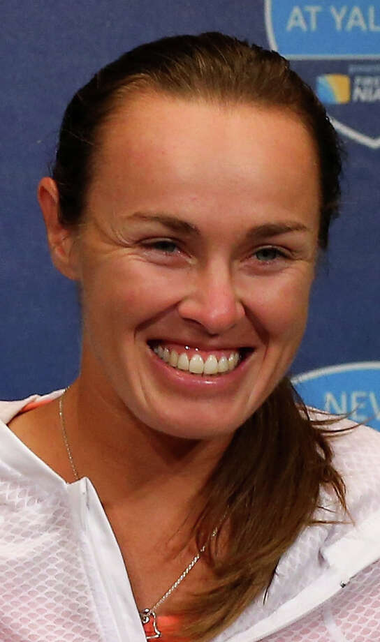 NEW HAVEN, CT - AUGUST 20:  The doubles team of  Martina Hingis of Switzerland and Daniela Hantuchova of Slovakia answer questions at a press conference after the loss to the team of  Cara Black of Zimbabwe and Vania King of the USA uring Day Three of the New Have Open at Connecticut Tennis Center at Yale on August 20, 2013 in New Haven, Connecticut. Photo: Elsa, Getty Images / 2013 Getty Images