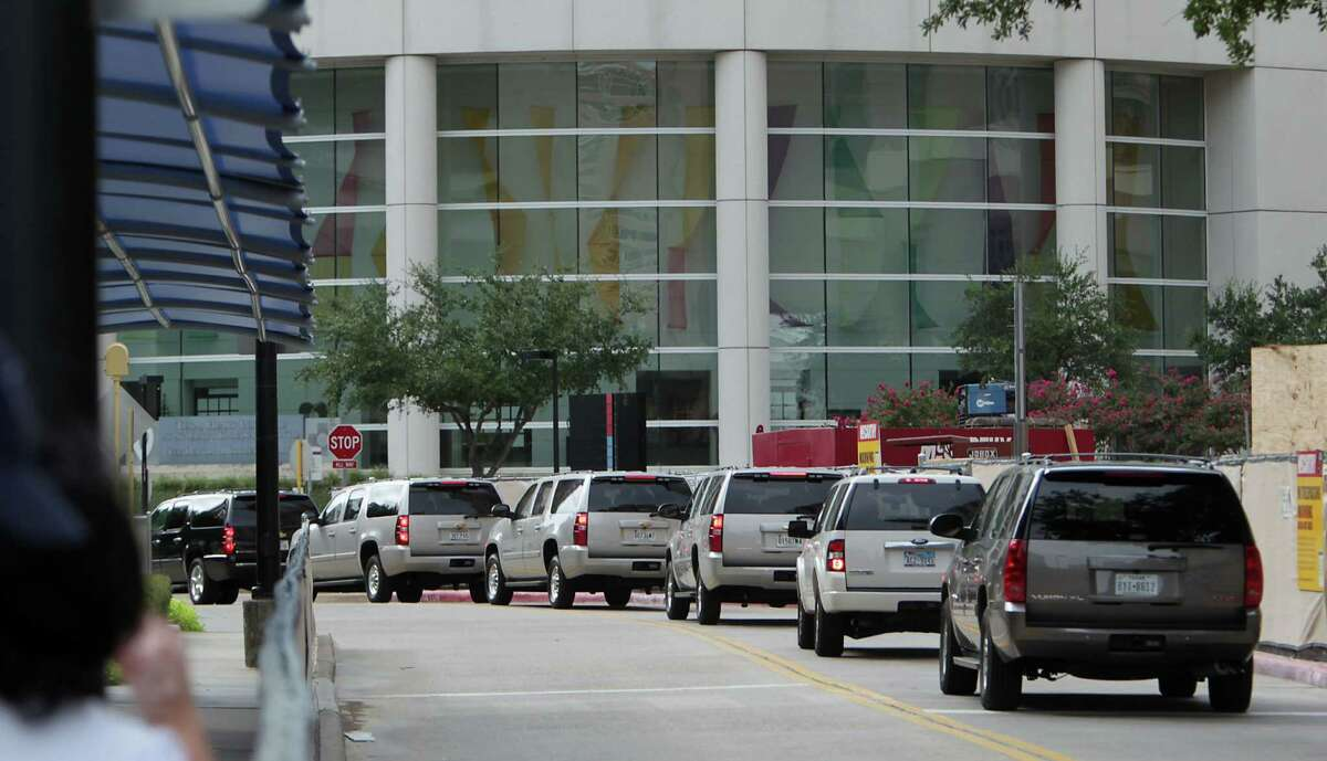 Vehicles that are part of Vice President Joe Biden's motorcade drive through the Texas Medical Center Tuesday, Aug. 20, 2013, in Houston. The Vice President's son Beau Biden is undergoing tests at MD Anderson Cancer Center.