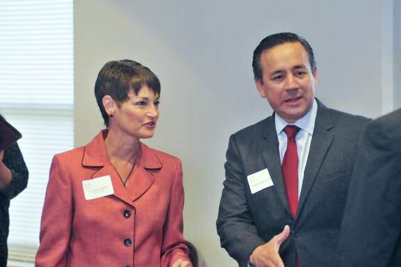 October 24, 2012 -- Texas Senate District 25 candidate, Republican Dr. Donna Campbell and District 19 Senator Carlos Uresti greet people prior to the Children's Shelter Legislative Breakfast Wednesday morning.