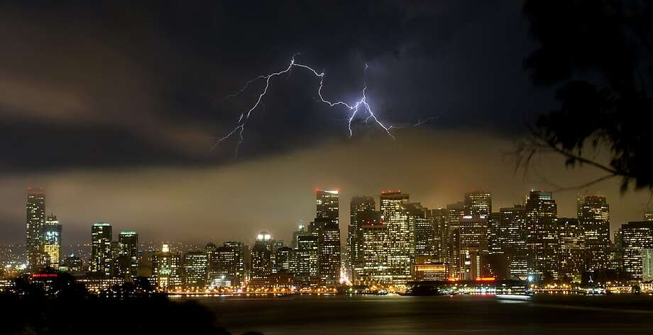 Lightning forks over downtown San Francisco on Monday, Aug. 19, 2013. Thunder and lightning is likely in the Bay Area after 5 p.m. through Friday morning, raising fire danger.  Photo: Noah Berger, Associated Press