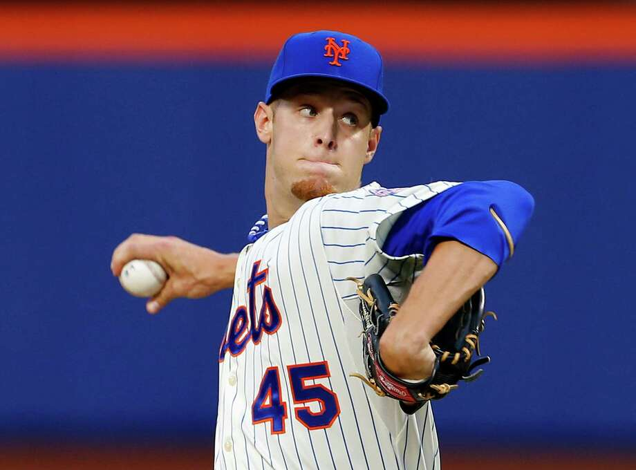 NEW YORK, NY - AUGUST 20: Pitcher Zack Wheeler #45 of the New York Mets delivers a pitch against the Atlanta Braves during a game on August 20, 2013 at Citi Field in the Flushing neighborhood of the Queens borough of New York City. (Photo by Rich Schultz/Getty Images) ORG XMIT: 163495111 Photo: Rich Schultz / 2013 Getty Images