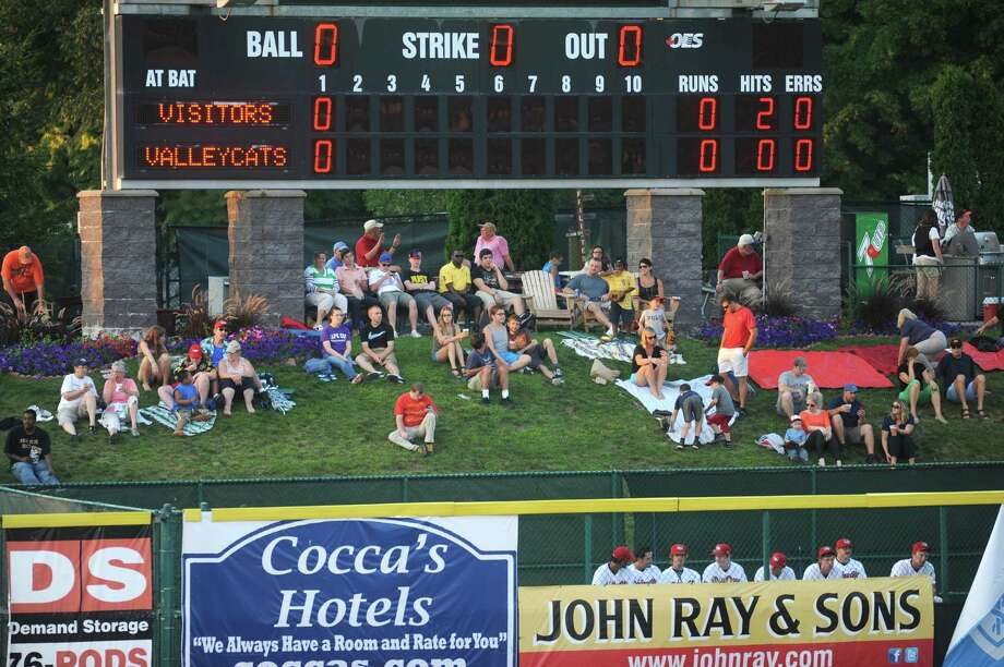A crowd sits on the grass above left field during the ValleyCats against Vermont baseball game at Bruno Stadium on Tuesday Aug. 20, 2013 in Troy, N.Y. (Michael P. Farrell/Times Union) Photo: Michael P. Farrell / 00023558A