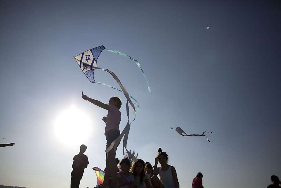 JERUSALEM, ISRAEL - AUGUST 20:  (ISRAEL OUT)  Israelis fly kites during a Kite-flying Festival on August 20, 2013 in Jerusalem, Israel. The event was the  28th Annual Kite-flying Festival at the Israeli Museum. (Photo by Lior Mizrahi/Getty Images) *** BESTPIX *** Photo: Lior Mizrahi, Getty Images