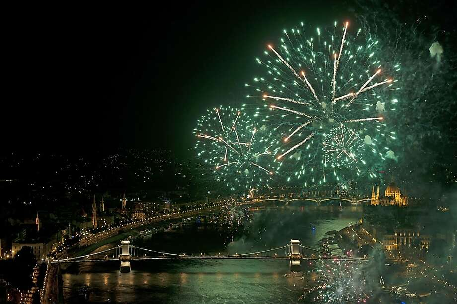 Fireworks explode above River Danube and the Chain Bridge as part of celebrations of the national holiday in central Budapest, Hungary, Tuesday, Aug. 20, 2013. This is one of the country's major national holidays when Hungarians commemorate the foundation of their state and its founder King St. Stephen. (AP Photo/MTI, Peter Lakatos) Photo: Peter Lakatos, Associated Press