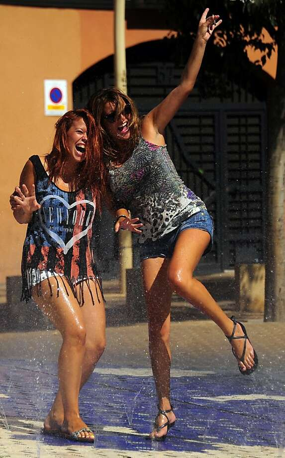 Youth cool off in a fountain of Sevilla where temperatures exceeded 40 degres on August 20, 2013.   AFP PHOTO/ CRISTINA QUICLERCRISTINA QUICLER/AFP/Getty Images Photo: Cristina Quicler, AFP/Getty Images