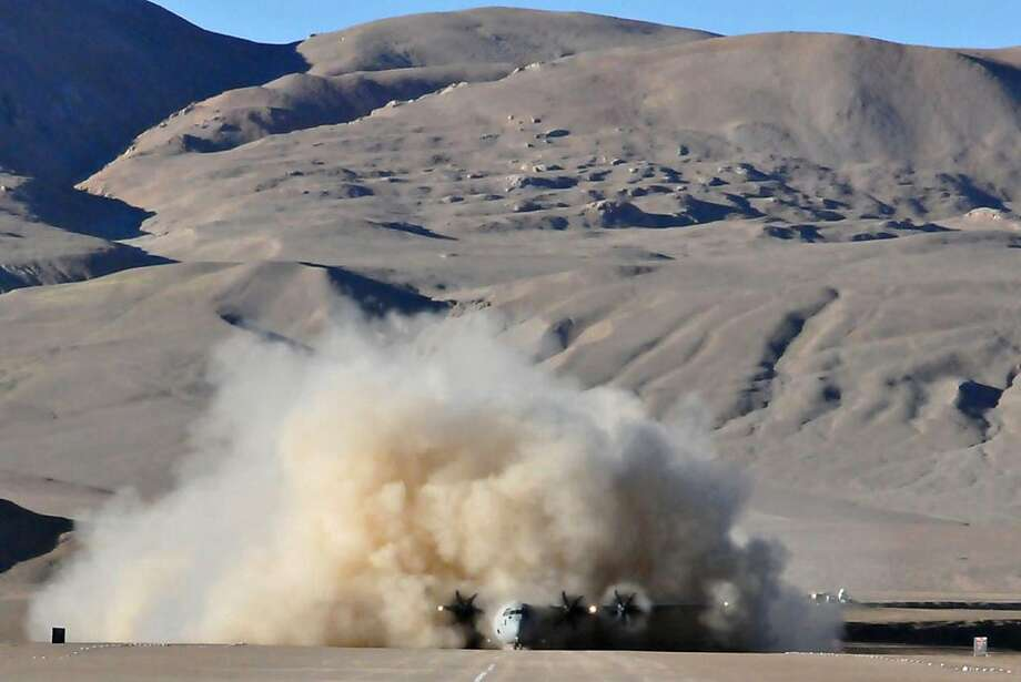 "In this handout photograph released by the Ministry of Defence, an Indian Air Force Lockheed Martin C-130J Super Hercules kicks up a cloud of dust after landing at the high-altitude Daulat Beg Oldie military airstrip in the Ladakh region of the Indian Himalayas on August 20, 2013. The C-130J aircraft made its first successful landing at the airstrip, the world's highest at 16,614 feet (5,065 meters), which is serviced by the smaller twin-turboprop engined Antonov An-32 and military helicopters. AFP PHOTO/MINISTRY OF DEFENCE    ----EDITORS NOTE ----RESTRICTED TO EDITORIAL USE MANDATORY CREDIT ""AFP PHOTO/MINISTRY OF DEFENCE"" NO MARKETING NO ADVERTISING CAMPAIGNS - DISTRIBUTED AS A SERVICE TO CLIENTSMINISTRY OF DEFENCE/AFP/Getty Images Photo: Ministry Of Defence, AFP/Getty Images"