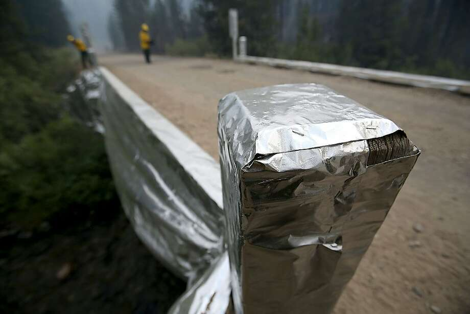 In this Monday, Aug. 19, 2013 photo, bridges over Baker Creek have been wrapped in aluminum foil to protect them from the 104,457-acre Beaver Creek Fire in the Baker Creek area, north of Ketchum, Idaho. (AP Photo/Times-News, Ashley Smith) Photo: Ashley Smith, Associated Press