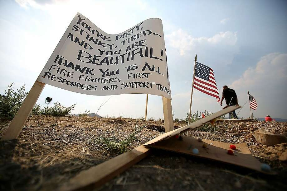 A sign thanking firefighters greets people at the main fire base for the Beaver Creek Fire north of Hailey, Idaho on Tuesday Aug. 20, 2013. (AP Photo/The Times-News, Ashley Smith) MANDATORY CREDIT Photo: Ashley Smith, Associated Press