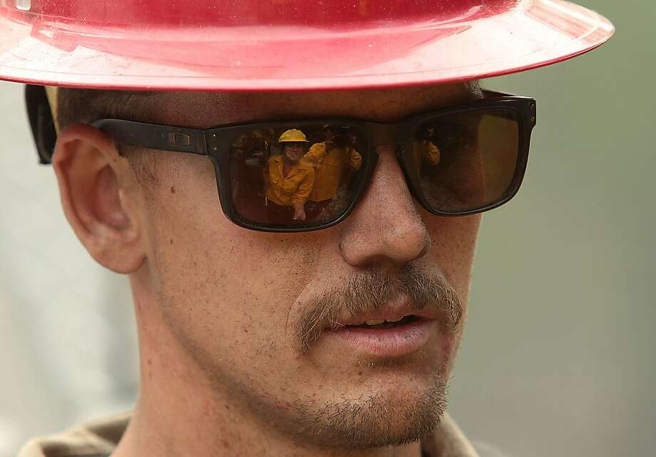 In this Monday, Aug. 19, 2013 photo, firefighter Gerard House, with private contract company Blaze Runner, talks with media while mopping up part of the 104,457-acre Beaver Creek Fire in the Baker Creek area, north of Ketchum, Idaho. (AP Photo/The Times-News, Ashley Smith) Photo: Ashley Smith, Associated Press