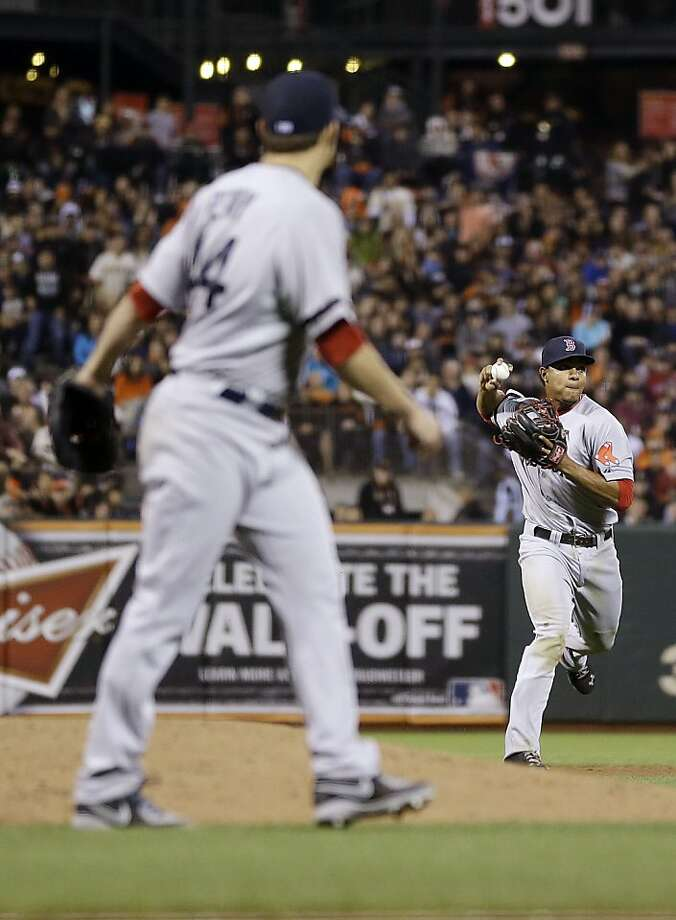 Boston Red Sox shortstop Xander Bogaerts, right, throws out San Francisco Giants' Marco Scutaro at first base during the fifth inning a baseball game on Tuesday, Aug. 20, 2013, in San Francisco. (AP Photo/Marcio Jose Sanchez) Photo: Marcio Jose Sanchez, Associated Press