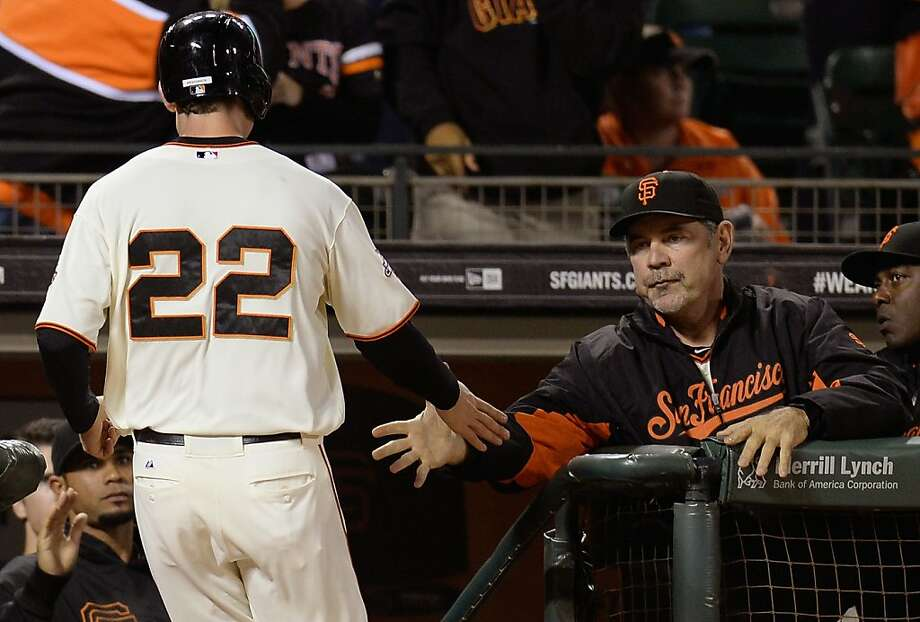 SAN FRANCISCO, CA - AUGUST 20:  Roger Kieschnick #22 of the San Francisco Giants is congratulated by manager Bruce Bochy #15 after Kieschnick scored on a Joaquin Arias RBI triple in the fifth inning against the Boston Red Sox at AT&T Park on August 20, 2013 in San Francisco, California.  (Photo by Thearon W. Henderson/Getty Images) Photo: Thearon W. Henderson, Getty Images