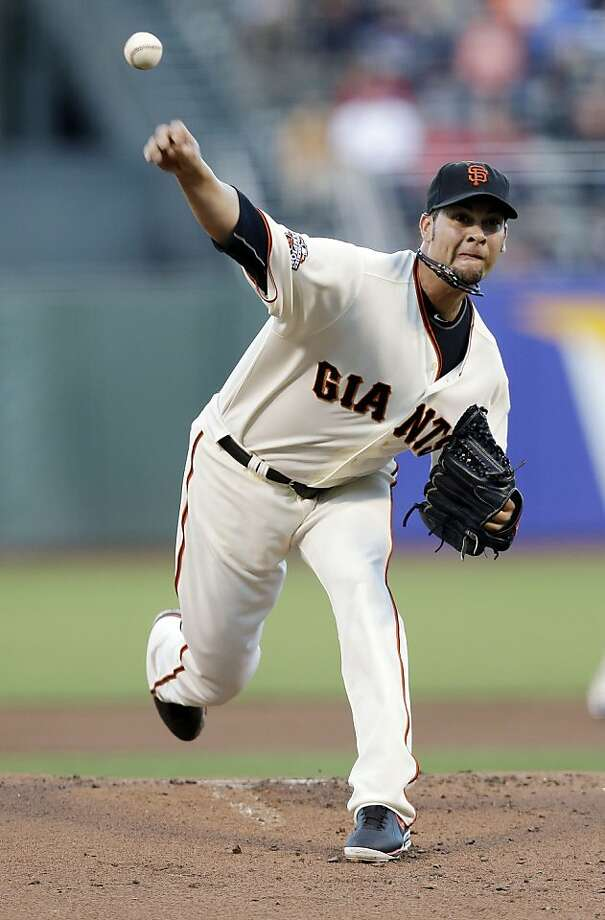 San Francisco Giants starting pitcher Ryan Vogelsong throws to the Boston Red Sox during the first inning of a baseball game Tuesday, Aug. 20, 2013, in San Francisco. (AP Photo/Marcio Jose Sanchez) Photo: Marcio Jose Sanchez, Associated Press