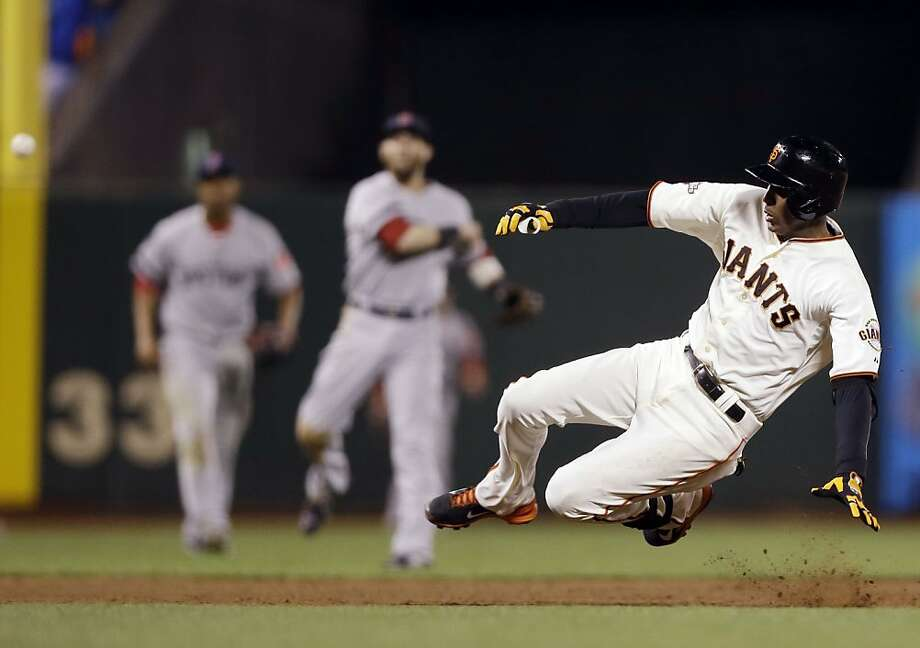 San Francisco Giants' Joaquin Arias slides into third base with an RBI triple against the Boston Red Sox during the fifth inning of a baseball game on Tuesday, Aug. 20, 2013, in San Francisco. (AP Photo/Marcio Jose Sanchez) Photo: Marcio Jose Sanchez, Associated Press