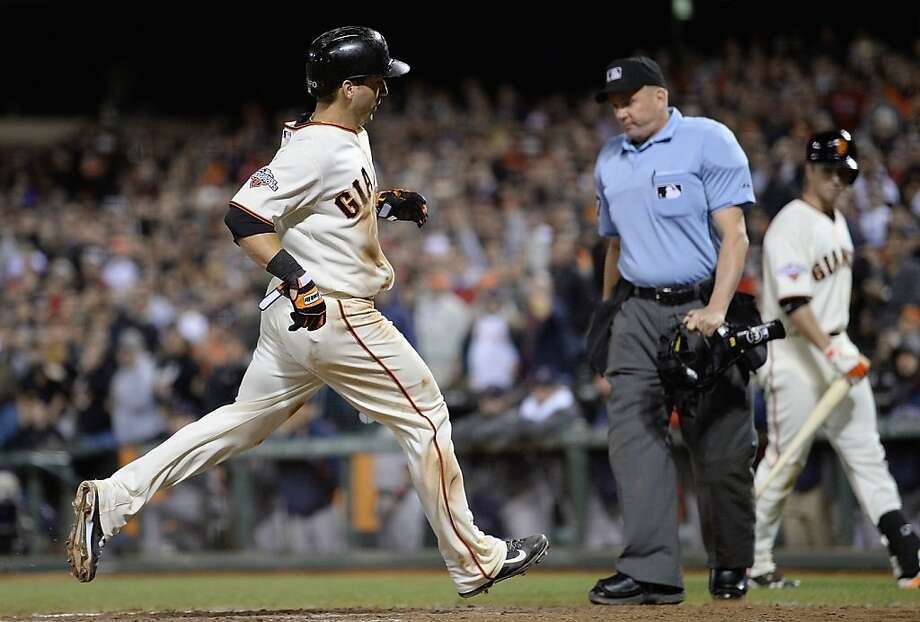 SAN FRANCISCO, CA - AUGUST 20:  Marco Scutaro #19 of the San Francisco Giants scores on a sacrifice fly from Buster Posey #28 in the eighth inning against the Boston Red Sox at AT&T Park on August 20, 2013 in San Francisco, California. Scutaro's score tied the game 2-2. (Photo by Thearon W. Henderson/Getty Images) Photo: Thearon W. Henderson, Getty Images