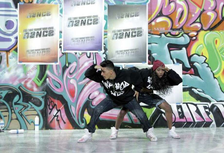 "SO YOU THINK YOU CAN DANCE: L-R: Top 8 contestant Paul Karmiryan and choreographer Comfort Fedoke perform a Hip-Hop routine to ""Dum Dum"" choreographed by Comfort Fedoke on SO YOU THINK YOU CAN DANCE airing Tuesday, August 20 (8:00-10:00 PM ET/PT) on FOX. ©2013 FOX Broadcasting Co. Cr: Adam Rose Photo: Simon Cordova, @simoncordova / @simoncordova"