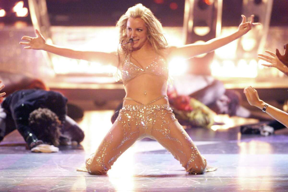 Keep clicking to go back in time to Spears' unforgettable outfits and performances at the VMAs.