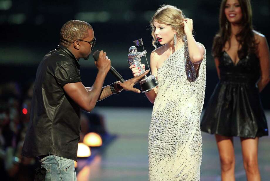 "2009:  Kayne West jumps onstage to grab the mike and argue that Beyonce should have won instead of a stunned Taylor Swift for ""Best Female Video."" Photo: Christopher Polk, Getty Images / 2009 Getty Images"