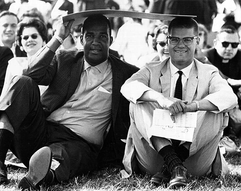 Two young men sit under a piece of cardboard to shield themselves from the sun August 28, 1963 during a civil rights rally in front of the Lincoln Memorial. Photo: National Archives, Getty Images / Hulton Archive