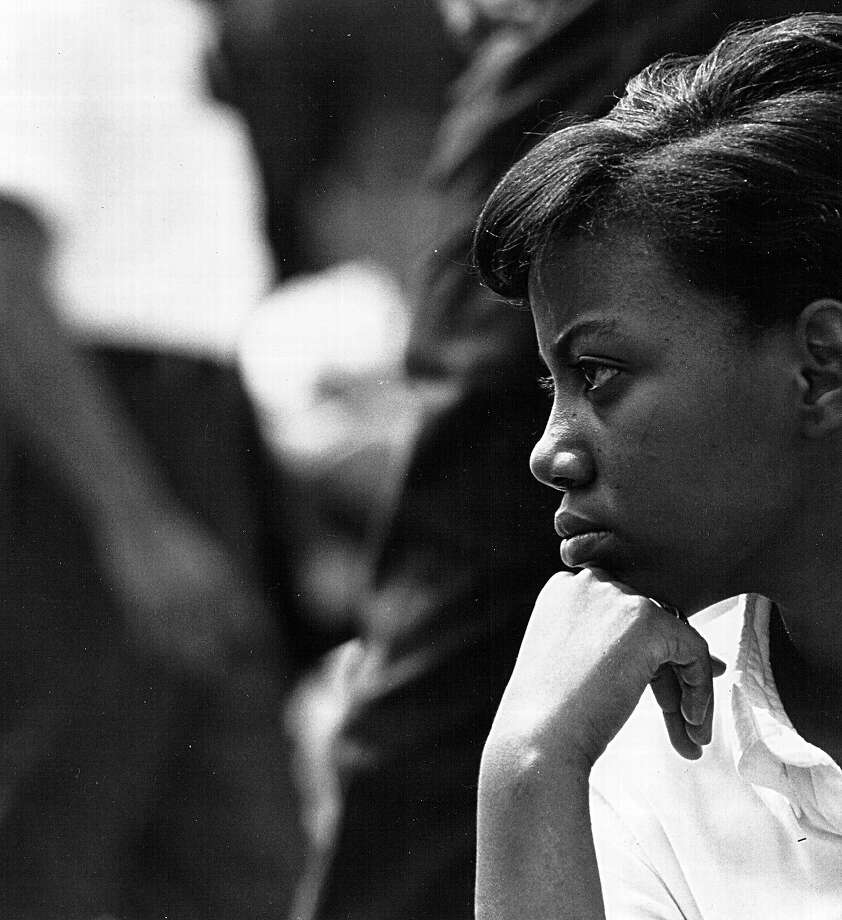 A young woman listens to speakers during a civil rights rally August 28, 1963 in Washington. Photo: National Archives, Getty Images / Hulton Archive