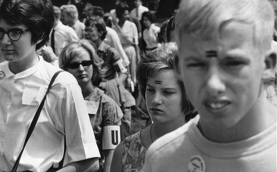 Young demonstrators with painted equal signs on their forehead attend a civil rights rally August 28, 1963 in Washington. Photo: National Archives, Getty Images / Hulton Archive
