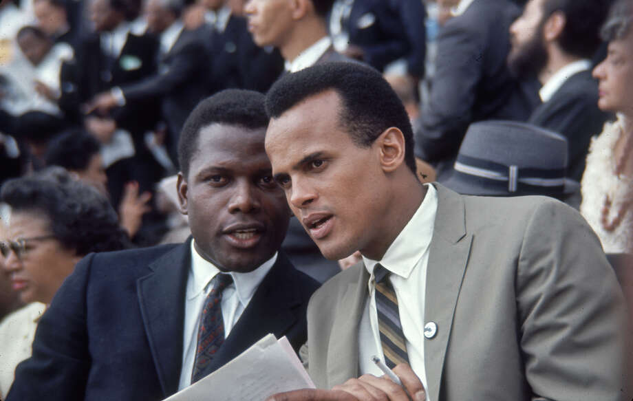 American Civil Rights activists actor Sidney Poitier (left) and singer Harry Belafonte talk together during the March on Washington for Jobs and Freedom. Photo: Francis Miller / Time & Life Pictures