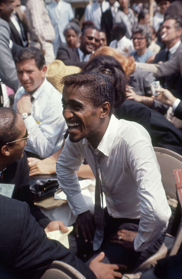 Singer and actor Sammy Davis Jr.laughs as he speaks with an unidentified man at the rally during the March on Washington. Photo: Francis Miller / Time & Life Pictures