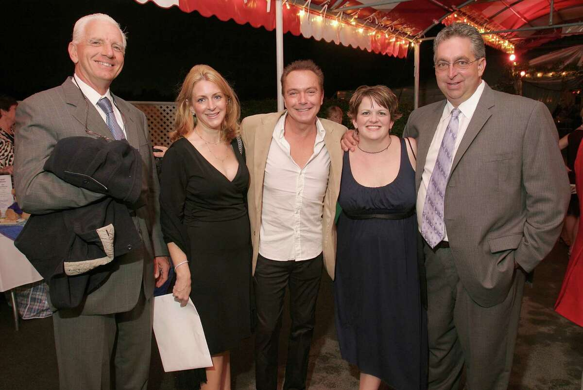 Saratoga Springs, NY - August 23, 2007 - (Photo by Joe Putrock/Special to the Times Union) - Jerry Bilinski, DVM(left), and his wife, Darlene(2nd from left), 70's television star, David Cassidy(center), Jennifer(2nd from left) and Gary(right) Contessa at the Travers Celebration.
