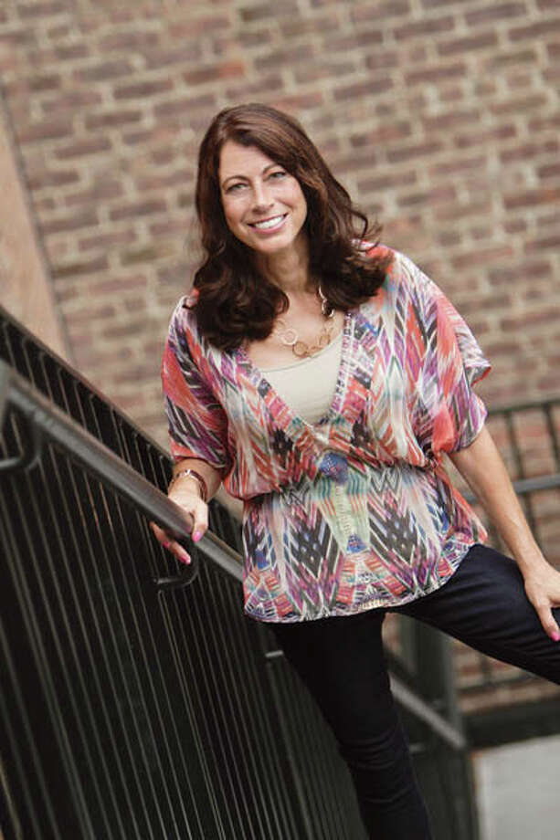 Blouse by One World, camisole by Architect, jeans by Calvin Klein, jewelry by Ashley Madison. Photo: Photo Taken By Suzanne Kawola At The Fort Orange Club, Albany.
