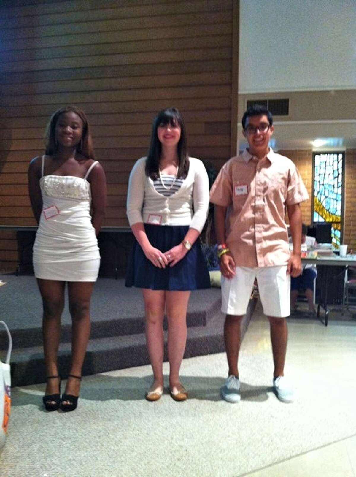 Adetoun Taiwo, from left, Caroline Rosson and Daniel Carvajal received $1,000 scholarships from the Kingwood Area Quilt Guild.
