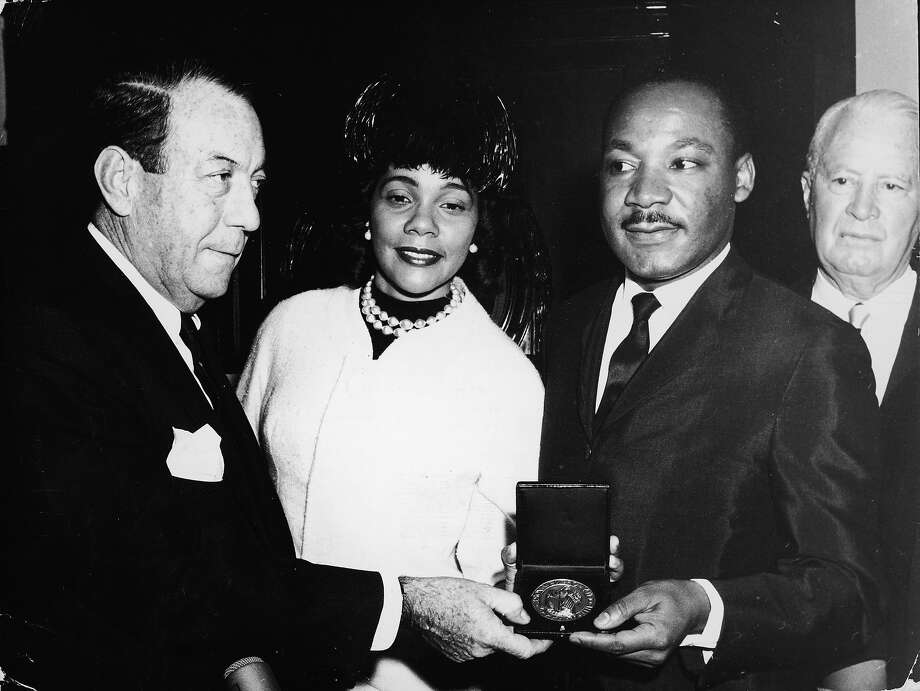 Civil rights leader Dr. Martin Luther King, Jr. stands with his wife Coretta and New York City Mayor Robert F. Wagner as is presented with the Medal of Honor of the City of NY, New York City, December 18, 1964. Photo: Agence France Presse, Getty Images / 2003 Getty Images