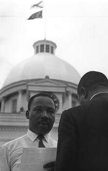 American civil rights campaigner Rev. Martin Luther King Jr. addresses a crowd in front of the Capitol Building in Montgomery, Alabama, following a black voting rights march from Selma, Alabama. Photo: William Lovelace, Getty Images / Hulton Archive