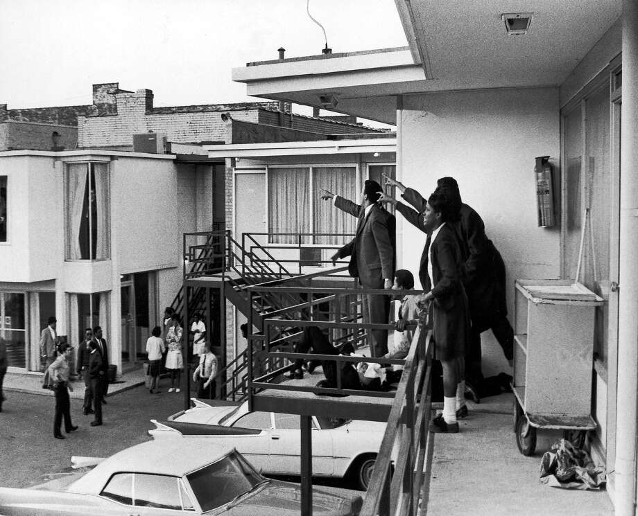 Dr. Ralph Abernathy and Jesse Jackson (both obscured) and others stand on the balcony of Lorraine motel and point in the direction of gun shots that killed American civil rights leader Rev. Martin Luther King, Jr., who lies at their feet, Memphis, Tennessee, April 4, 1968. Photo: Joseph Louw, Time & Life Pictures/Getty Image / Time Life Pictures