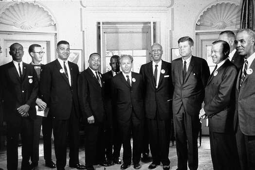 American President John F Kennedy (1917 - 1963) in the White House with leaders of the civil rights 'March on Washington' (right to left) Roy Wilkins (1910 - 1981), Walter Reuther (1907 - 1970), Vice-President Lyndon Baines Johnson (1908 - 1973), John F Kennedy, A Philip Randolph (1889 - 1979), Rabbi Joachim Prinz, John Lewis, Rev. Martin Luther King (1929 - 1968) and Whitney Young (1922 - 1971). Photo: MPI, Getty Images / Archive Photos