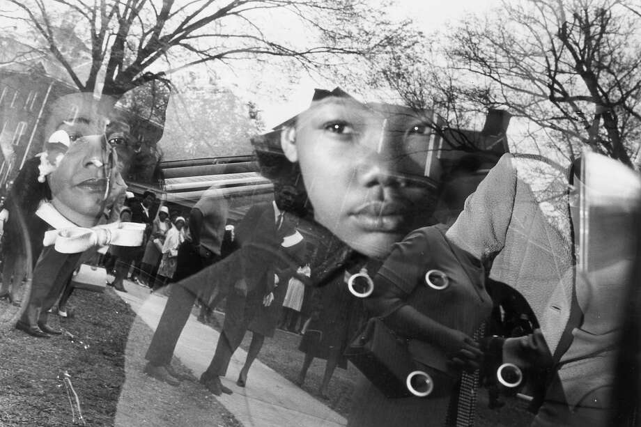 Coretta Scott King, widow of Rev. Martin Luther King Jr., and her daughter, Yolanda, sit in a car as it leaves for Martin Luther King Jr's funeral, Atlanta, Georgia. The reflection of a group of mourners standing in front of a house is visible in the window of the car. Photo: Santi Visalli Inc., Getty Images / Archive Photos